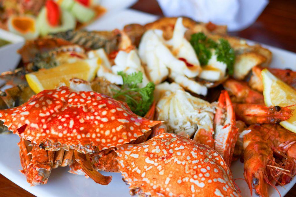 Sea food on big plate include shrimps ,lemon,squid and crab shel